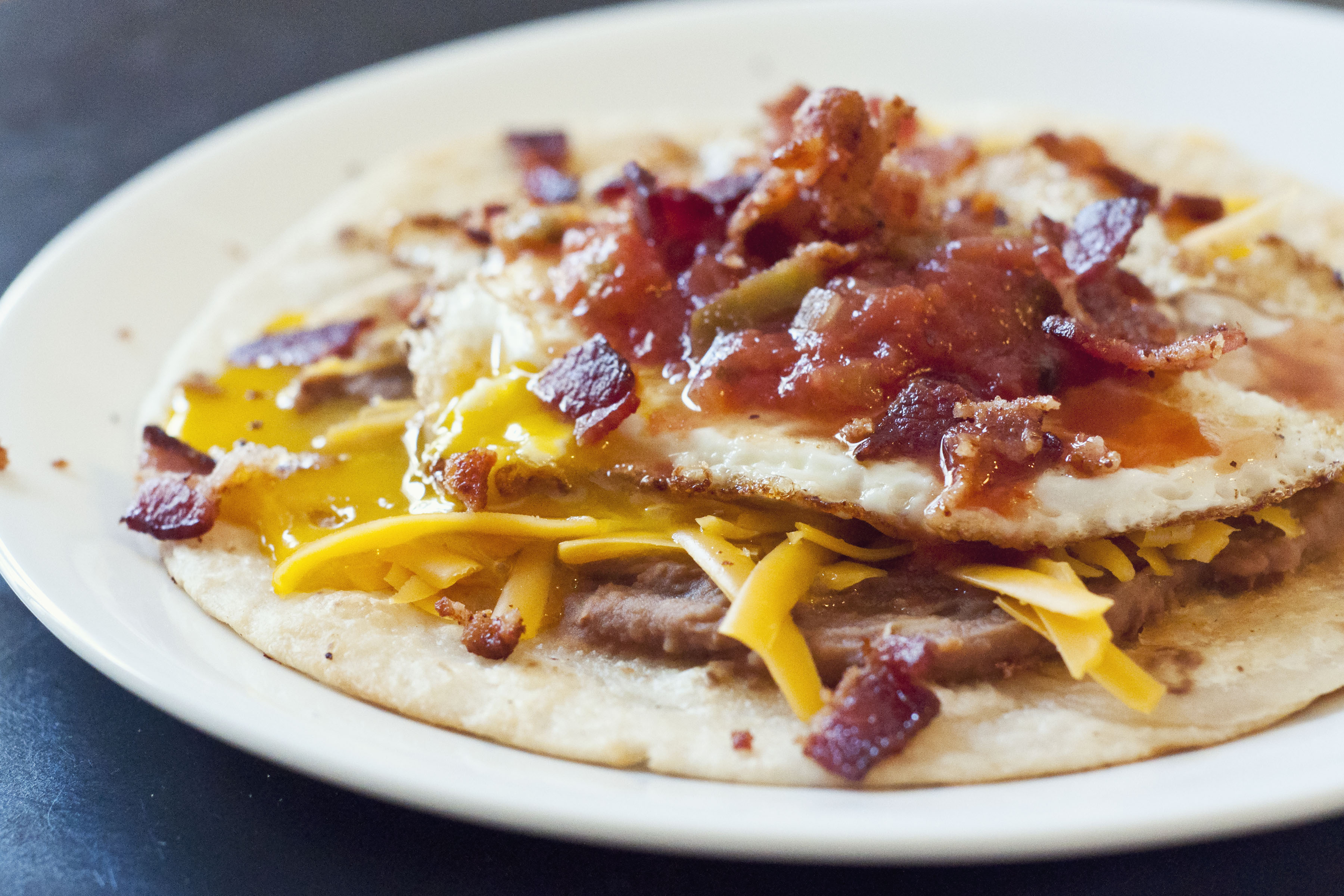 huevos rancheros, egg recipes, cheddar cheese, refried beans, bacon recipes, food, cooking, recipes, huevos rancheros recipes, breakfast recipes, taste arkansas,